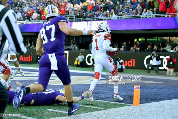 Jaylon Johnson of the Utah Utes intercepts a Jacob Eason of the Washington Huskies pass and returns it for a 39 yard for a touchdown during the third...