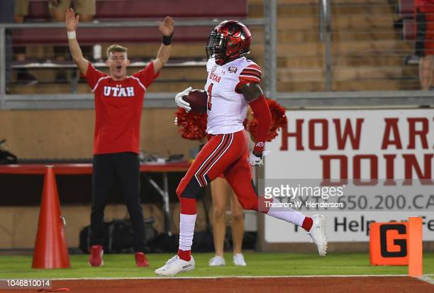 Jaylon Johnson of the Utah Utes returns an interception 100 yards for a touchdown against the Stanford Cardinal during the second quarter of their...