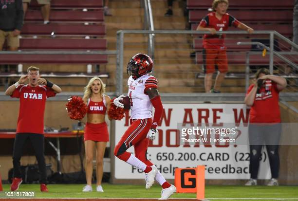Jaylon Johnson of the Utah Utes returns an interception for a touchdown against the Stanford Cardinal during the second quarter of their NCAA...
