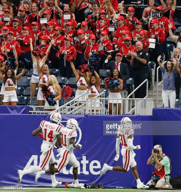 Jaylon Jones of the Mississippi Rebels runs back the kick 94 yards in the first quarter against the Texas Tech Red Raiders as DK Metcalf and Floyd...