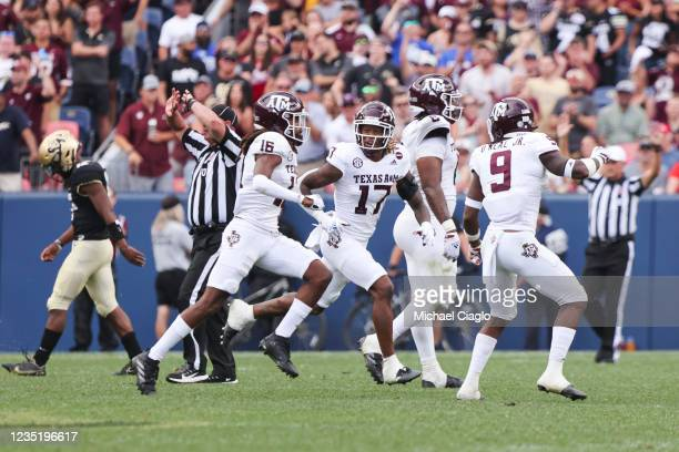 Jaylon Jones of the Texas A&M Aggies celebrates with his teammates after making a defensive stop on fourth down against the Colorado Buffaloes during...