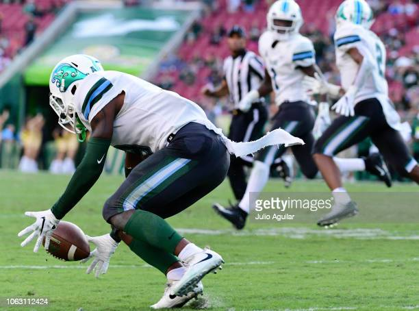 Jaylon Monroe of the Tulane Green Wave recovers a blocked extra point attempt by Coby Weiss of the South Florida Bulls at Raymond James Stadium on...