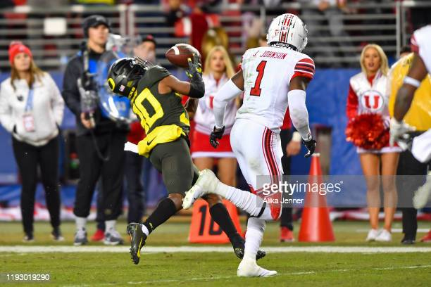 Jaylon Redd of the Oregon Ducks reaches for a pass from Justin Herbert during the Pac12 Championship football game against the Utah Utes at Levi's...