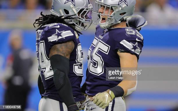 Jaylon Smith and Leighton Vander Esch of the Dallas Cowboys celebrate a third down stop during the second quarter of the game against the Detroit...