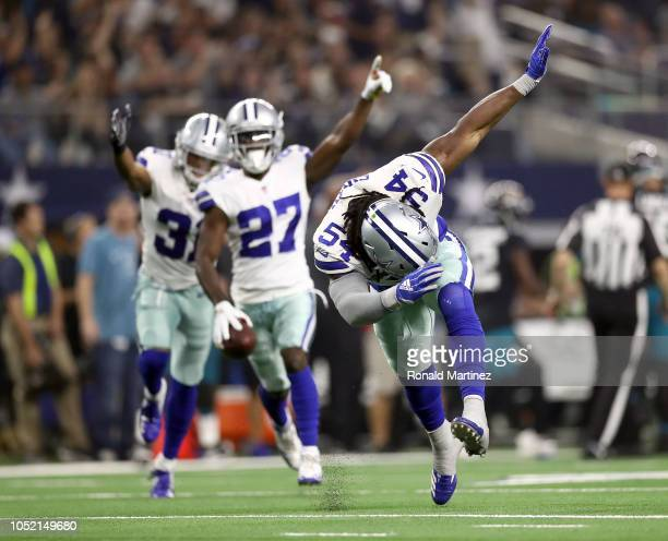Jaylon Smith and the Dallas Cowboys celebrate a fumble recovery in the third quarter of a game against the Jacksonville Jaguars at ATT Stadium on...