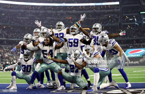 Jaylon Smith and the Dallas Cowboys defense celebrate a fumble recovery against the Jacksonville Jaguars at ATT Stadium on October 14 2018 in...
