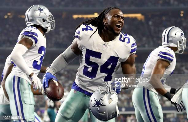 Jaylon Smith of the Dallas Cowboys celebrates a fumble recovery against the Jacksonville Jaguars at ATT Stadium on October 14 2018 in Arlington Texas