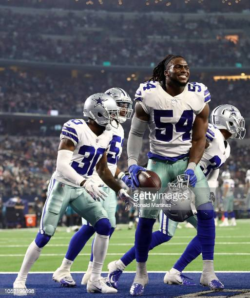 Jaylon Smith of the Dallas Cowboys celebrates a fumble recovery against the Jacksonville Jaguars at AT&T Stadium on October 14, 2018 in Arlington,...