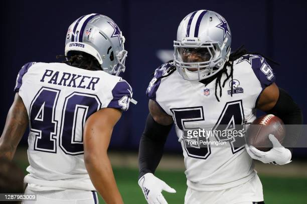 Jaylon Smith of the Dallas Cowboys celebrates his interception alongside Steven Parker during the third quarter of a game against the Washington...