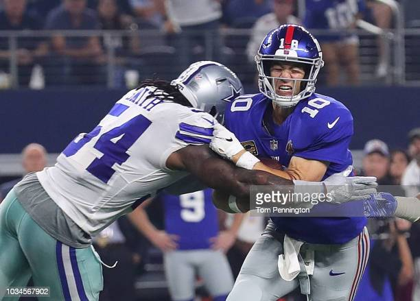 Jaylon Smith of the Dallas Cowboys hits Eli Manning of the New York Giants in the third quarter at AT&T Stadium on September 16, 2018 in Arlington,...