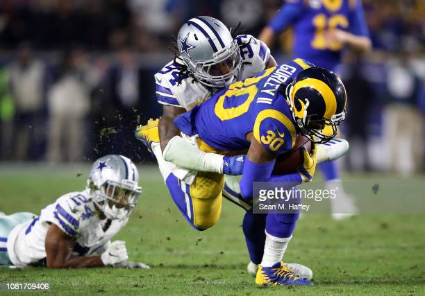 Jaylon Smith of the Dallas Cowboys tackles Todd Gurley of the Los Angeles Rams in the second half in the NFC Divisional Playoff game at Los Angeles...