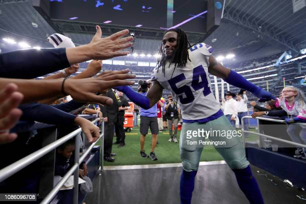 Jaylon Smith of the Dallas Cowboys walks off the field after the Dallas Cowboys beat the Tampa Bay Buccaneers 2720 at ATT Stadium on December 23 2018...
