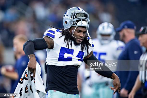 Jaylon Smith of the Dallas Cowboys warms up with a dance before a game against the Washington Redskins at ATT Stadium on November 22 2018 in...