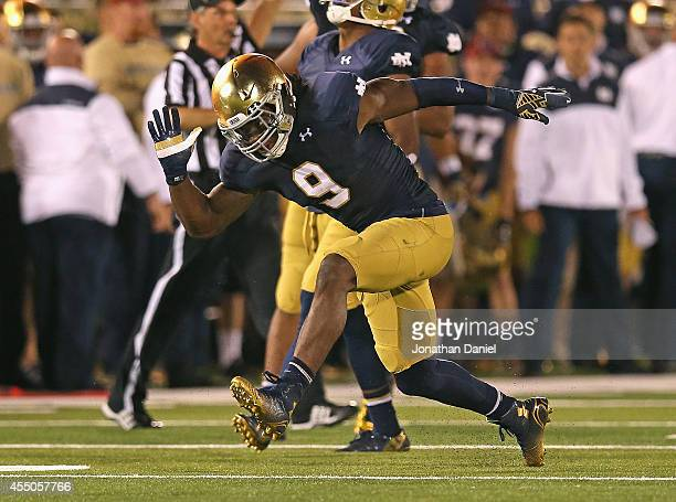 Jaylon Smith of the Notre Dame Fighting Irish celebrates a tackle for a loss against the Michigan Wolverines at Notre Dame Stadium on September 6,...