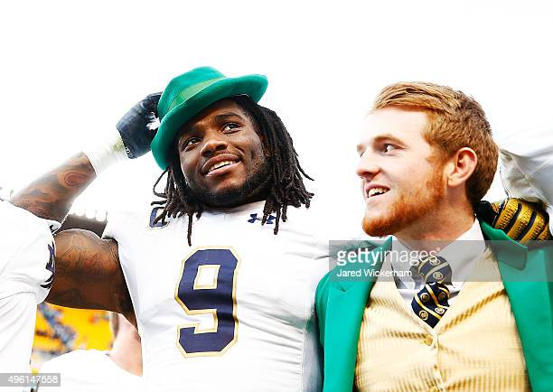 Jaylon Smith of the Notre Dame Fighting Irish celebrates by wearing the hat of team mascot Lucky The Leprechaun following their 4230 win against the...