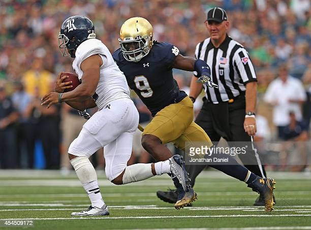 Jaylon Smith of the Notre Dame Fighting Irish moves to tackle Darik Dillard of the Rice Owls at Notre Dame Stadium on August 30 2014 in South Bend...