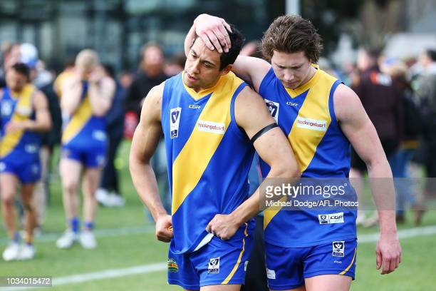 Jaylon Thorpe of Williamstown who missed a goal in the dying seconds looks dejected alongside Billy Myers after defeat during the VFL Preliminary...