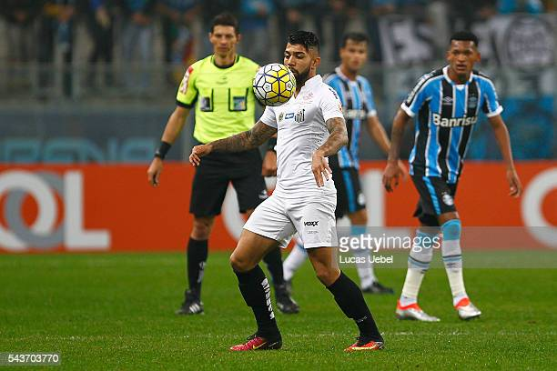 Jaylson of Gremio battles for the ball against Gabriel of Santos during the match Gremio v Santos as part of Brasileirao Series A 2016 at Arena do...