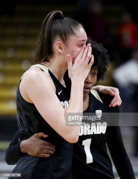Jaylyn Sherrod comforts Emma Clarke of the Colorado Buffaloes after a buzzerbeating half court shot from Kiana Williams of the Stanford Cardinal to...