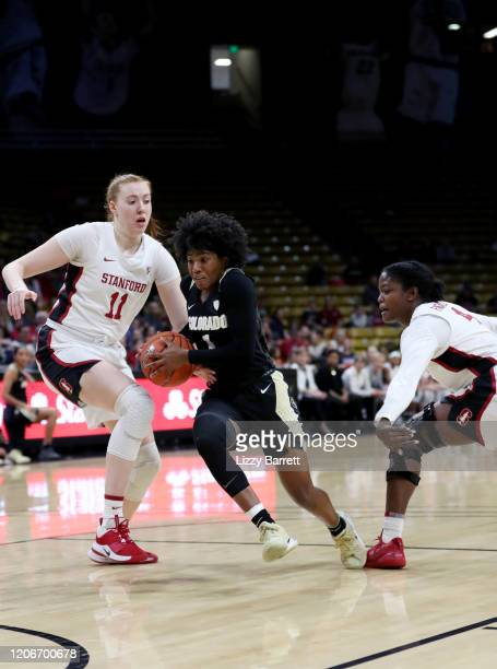 Jaylyn Sherrod of the Colorado Buffaloes drives to the net past the defense of Ashten Prechtel and Nadia Fingall of the Stanford Cardinal during the...