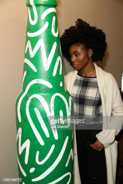 Jayme Lawson of Farewell Amor signs the Heineken bottle sculpture at TheWrap Studio at Sundance Film Festival on January 26 2020 in Park City Utah