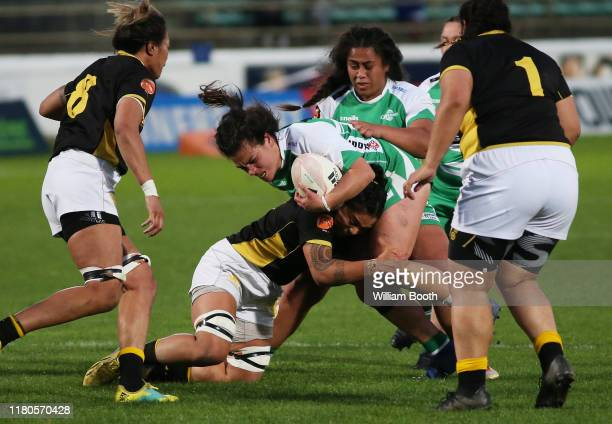 Jayme Nuku of Manawatu is tackled during the round 7 Farah Palmer Cup match between Manawatu and Wellington at Central Energy Trust Arena on October...