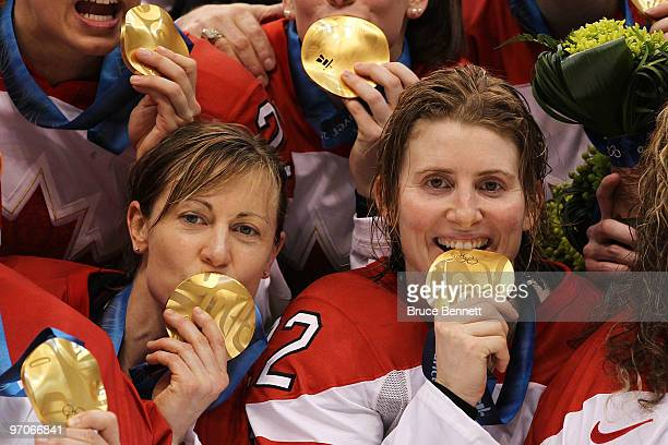 Jayna Hefford and Captain Hayley Wickenheiser of Canada celebrate after receiving the gold medal following their team's 20 victory during the ice...