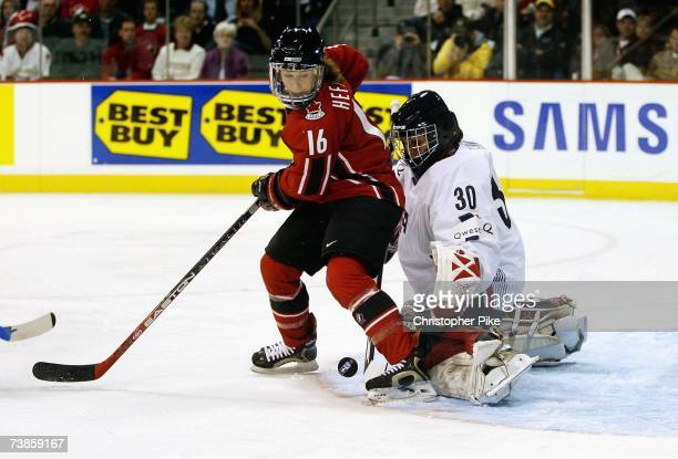 Jayna Hefford of Canada screens goalie Chanda Gunn of the USA in the first period of the IIHF Women's World Championship Gold Medal game on April 10...