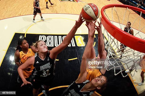 Jayne Appel and Jessica Kuester of the San Antonio Stars battle for a rebound with Courtney Paris and Amber Dvorak of the Tulsa Shock during the WNBA...