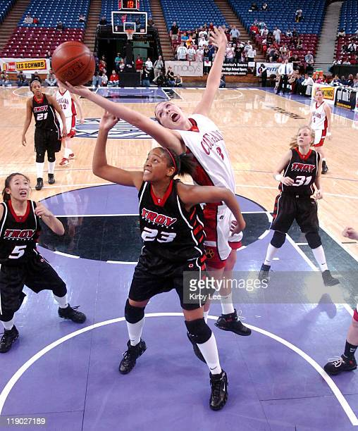 Jayne Appel of Carondelet stretches over Rhaya Neabors of Troy for a rebound during the Division II girls final in the CIF State Basketball...