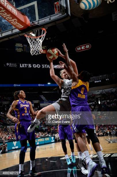 Jayne Appel of the San Antonio Stars rebounds the ball against Alana Beard of the Los Angeles Sparks at the ATT Center on August 10 2014 in San...