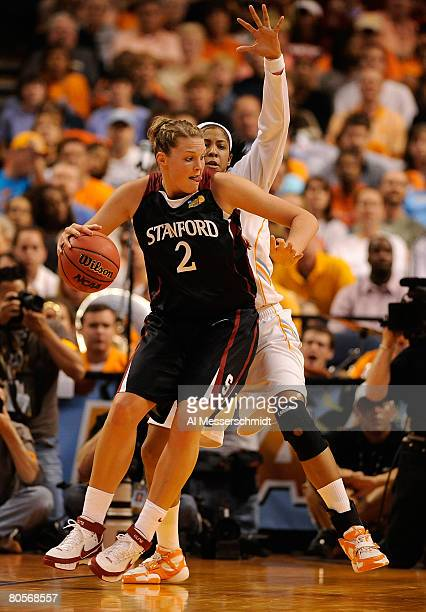 Jayne Appel of the Stanford Cardinal posts up against Candace Parker of the Tennessee Lady Volunteers during the National Championsip Game of the...