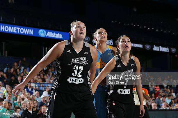 Jayne AppelMarinelli and Haley Peters of the San Antonio Stars fights for position against Elena Delle Donne of the Chicago Sky on September 4 2016...