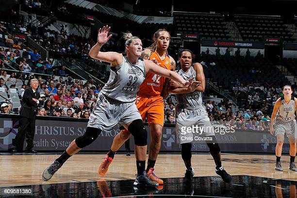 Jayne AppelMarinelli and Monique Currie of the San Antonio Stars fights for position against Brittney Griner of the Phoenix Mercury at the ATT Center...