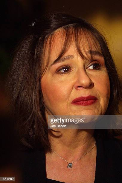Jayne Hawkins, the mother of Irving, Texas police Officer Aubrey Hawkins who was ambushed and killed, speaks to the press January 11, 2001 in Austin,...
