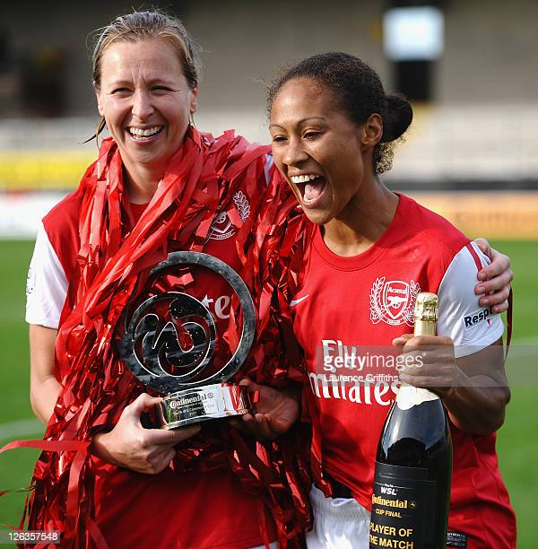 Jayne Ludlow and Rachel Yankee of Arsenal Ladies FC celebrate victory with the trophy during the FA WSL Continental Cup Final between Birmingham City...