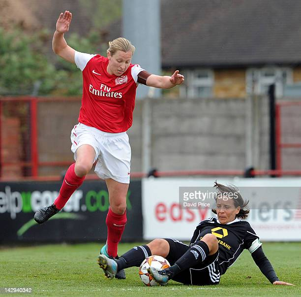 Jayne Luldow of Arsenal Ladies FC is tackled by Sandra Smisek of Frankfurt during the Women's Champions League Semi Final match between Arsenal...