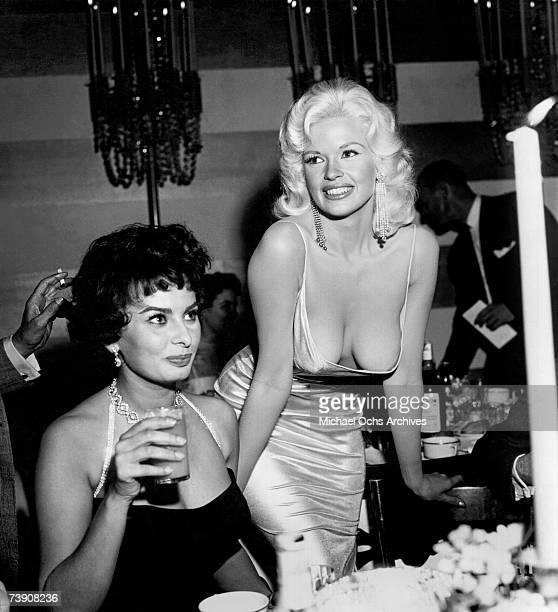 Jayne Mansfield attempts to steal the show at a 20th Century-Fox party to promote Sophia Loren on April 12, 1957 in Los Angeles, California.