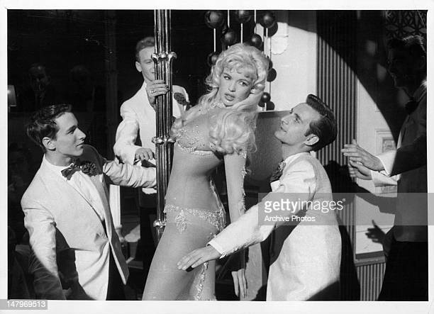 Jayne Mansfield dancing in nearly transparent nylon dress in a scene from the film 'Playgirl After Dark' 1960
