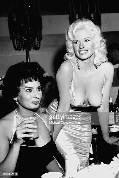 Jayne Mansfield tries to steal the show in a very low cut dress at a party thrown by 20th Century-Fox for Sophia Loren on April 12, 1957 in Los...