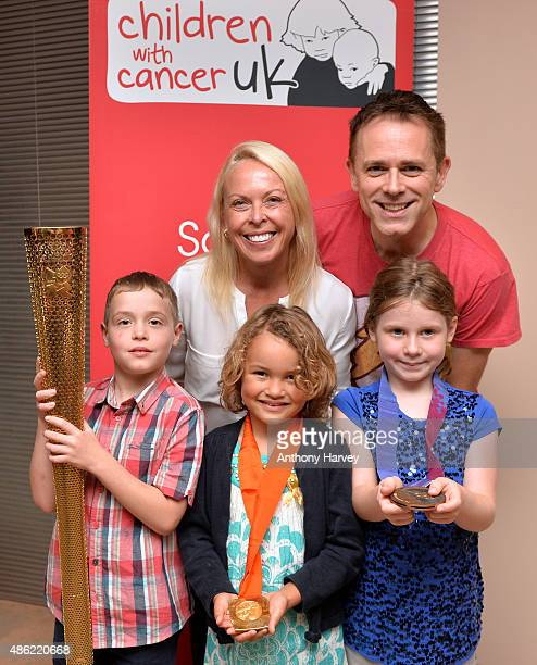 Jayne Torvill and Chris Jarvis with children who have suffered from cancer during a photocall ahead of a Golden Tea in aid of Childhood Cancer...