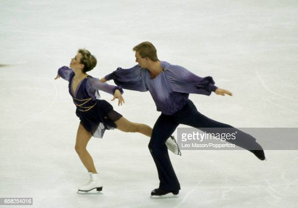 Jayne Torvill and Christopher Dean of Great Britain enroute to winning the gold medal in the ice dancing event during the Winter Olympic Games in...