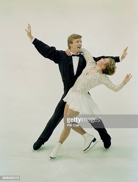 Jayne Torvill and Christopher Dean of Great Britain perform their 'Let's Face the Music and Dance' routine in the Mixed Ice Dancing for the Ice...
