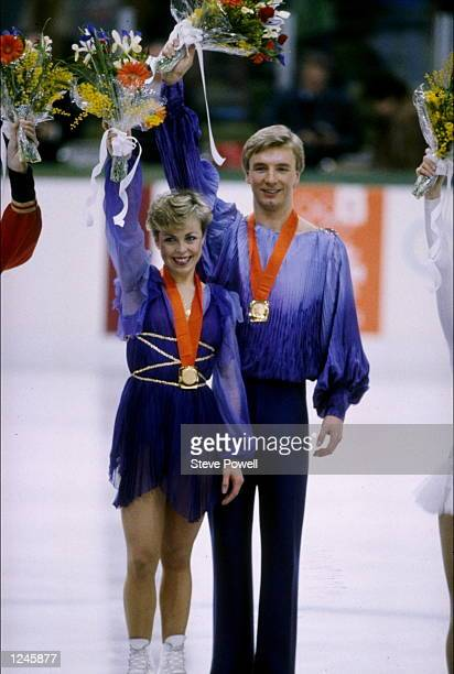 Jayne Torvill and Christopher Dean of Great Britain wave to the crowd pose with their gold medals after winning the ice dance in the figure skating...