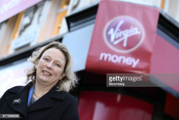 JayneAnne Gadhia chief executive officer of Virgin Money Holdings UK Ltd stands outside Virgin Money's first high street bank located in the former...