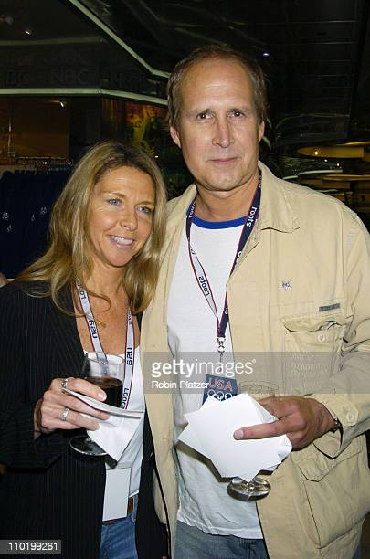 Jayni Chase and Chevy Chase during The Launch of the 2004 US Olympic Team Collection by Roots by Olympic Athletes at The NBC Experience Store in New...