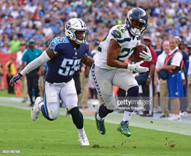 Jayon Brown of the Tennessee Titans chases CJ Prosise of the Seattle Seahawks after a long reception during the first half at Nissan Stadium on...