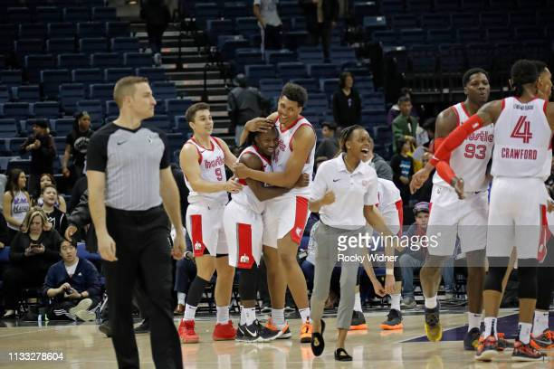 JayR Strowbridge of the Memphis Hustle celebrates with teammates against the Stockton Kings during the NBA G League Playoffs on March 27 2019 at the...