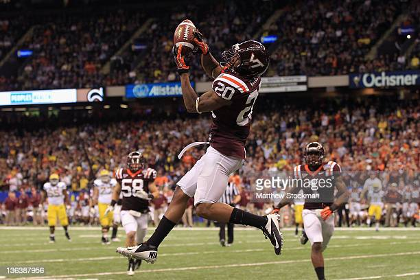 Jayron Hosley of the Virginia Tech Hokies intercepts a pass in the third quarter against of the Michigan Wolverines during the Allstate Sugar Bowl at...