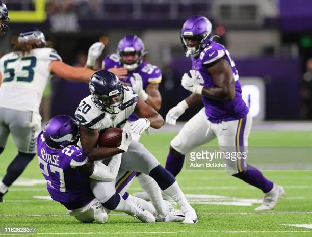 Jayron Kearse of the Minnesota Vikings tackles Rashaad Penny of the Seattle Seahawks during the pre-season game at U.S. Bank Stadium on August 18,...
